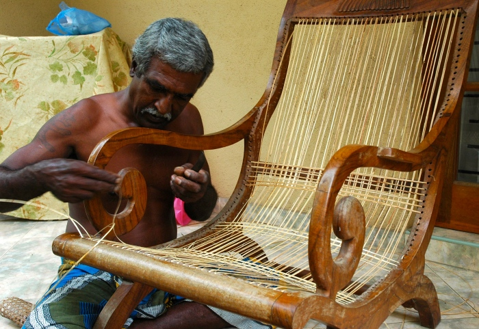 Traditional can-weaver repairing my recliner